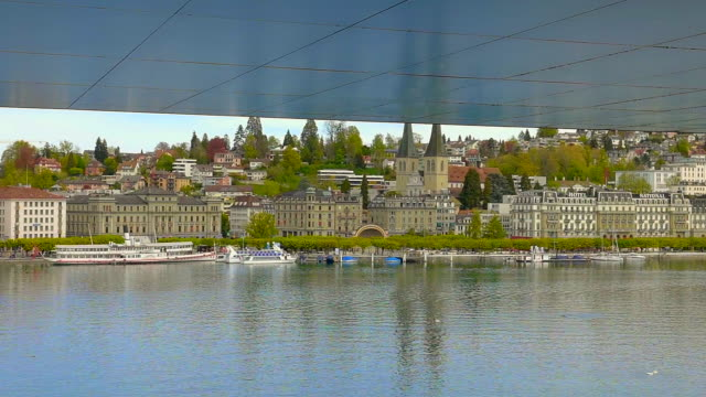 cityscape with roof and over lake lucerne - lake lucerne stock videos & royalty-free footage