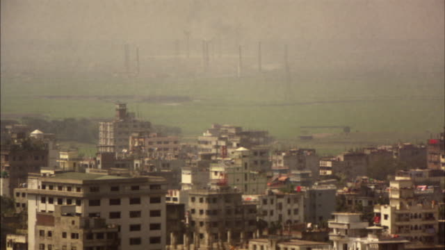 ws, cityscape with smoke stacks on horizon, dhaka, bangladesh - dhaka stock-videos und b-roll-filmmaterial
