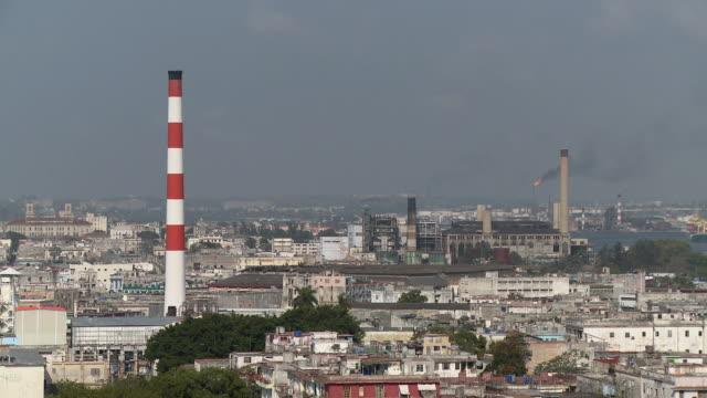 ws ha cityscape with smokestacks / havana, cuba - 工場の煙突点の映像素材/bロール