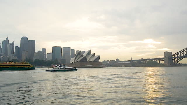 cityscape with sydney opera house / sydney, australia - moody sky stock videos & royalty-free footage