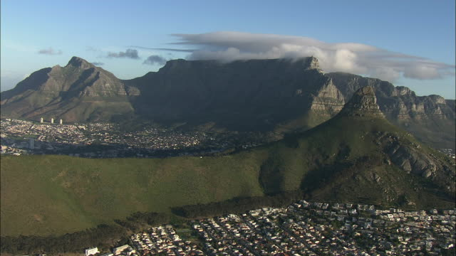 aerial cityscape with table mountain and lion's head, cape town, western cape, south africa - lion's head mountain stock videos and b-roll footage