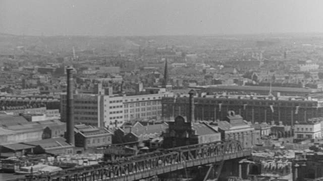 1940 PAN Cityscape with the Thames and several bridges / London, England, United Kingdom