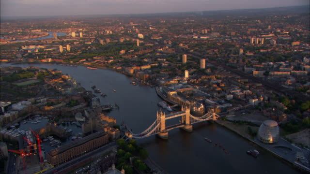 aerial, cityscape with tower bridge on thames river, london, england - river thames stock videos & royalty-free footage