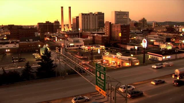 WS HA Cityscape with traffic on highway at sunset, Spokane, Washington, USA