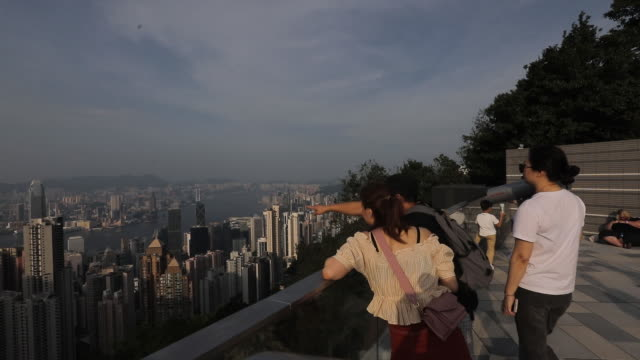 cityscape with victoria peak by day and night time hong kong china on wednesday august 28 2019 - victoria peak stock videos & royalty-free footage