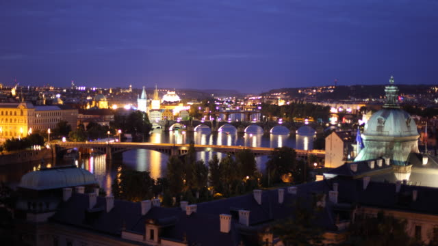 T/L WS HA Cityscape with Vltava river, dusk to night / Prague, Czech Republic