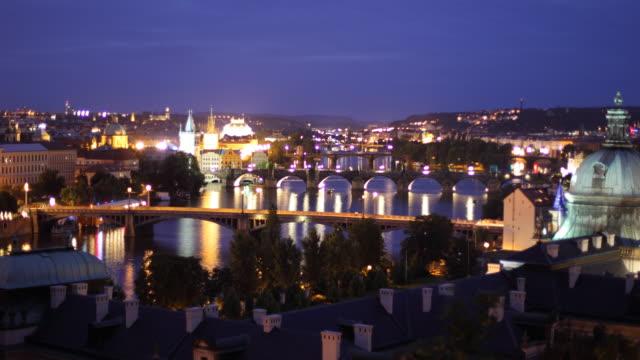 t/l ws ha zo cityscape with vltava river, dusk to night / prague, czech republic - river vltava stock videos & royalty-free footage