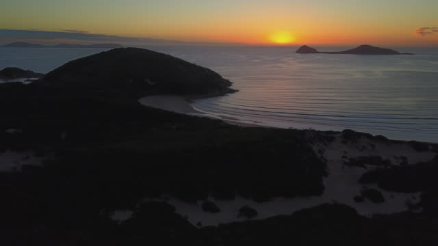 4K Cityscapes, Landscapes & Establishers: Sunset aerial view of Wilson Promontory, beach and landscape, Australia