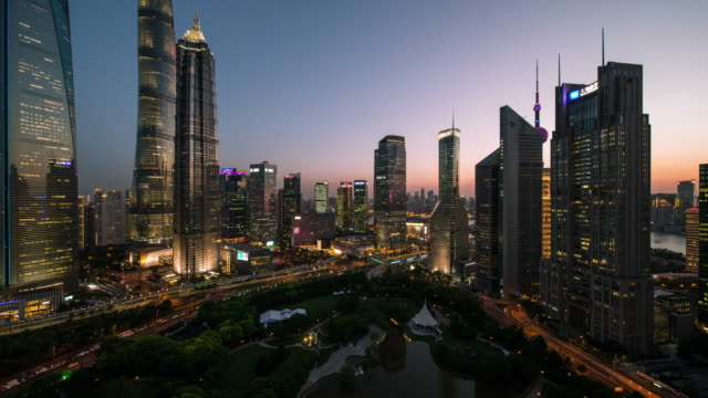 4k cityscapes of lujiazui shanghai china at dusk - shanghai tower stock videos & royalty-free footage