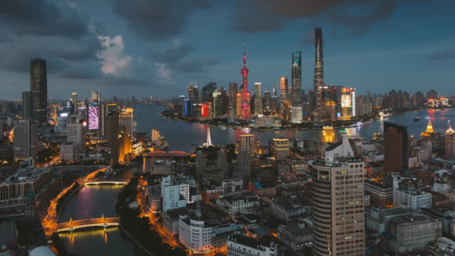 4k cityscapes of shanghai skyline at dusk - shanghai world financial center stock videos & royalty-free footage