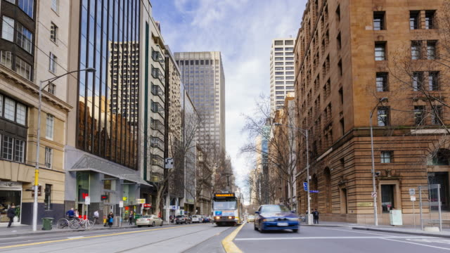 4k cityscapes time-lapse: collins street during winter, melbourne - tram stock videos & royalty-free footage