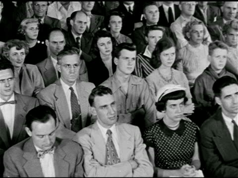 dramatization 'civil defense meeting' sign ms mixed audience looking at stage ws 'colonel' at podium talking to audience - anti communism stock videos & royalty-free footage