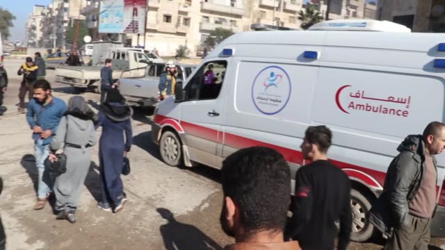 civil defense members and civilians conduct search and rescue works at site after assad regime forces' warplanes carried out airstrikes to... - air raid点の映像素材/bロール