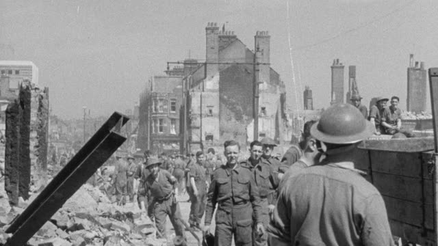 1942 montage civil defense services cleaning up after bombing by tearing down injured buildings during world war ii / bristol, england, united kingdom - world war ii video stock e b–roll