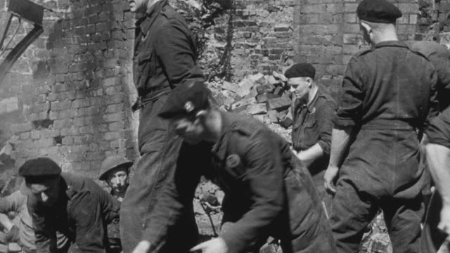 1942 montage civil defense services reporting on the injured list and the search for more casualties of the bombing during world war ii as workers dig through rubble / bristol, england, united kingdom - world war ii video stock e b–roll