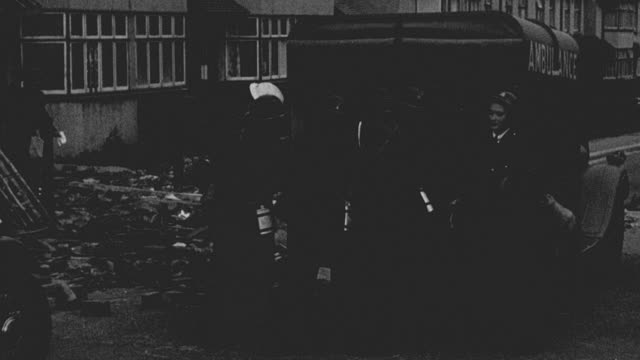 1942 montage civil defense workers ducking and covering from fresh air raid / bristol, england, united kingdom - bristol england stock videos & royalty-free footage