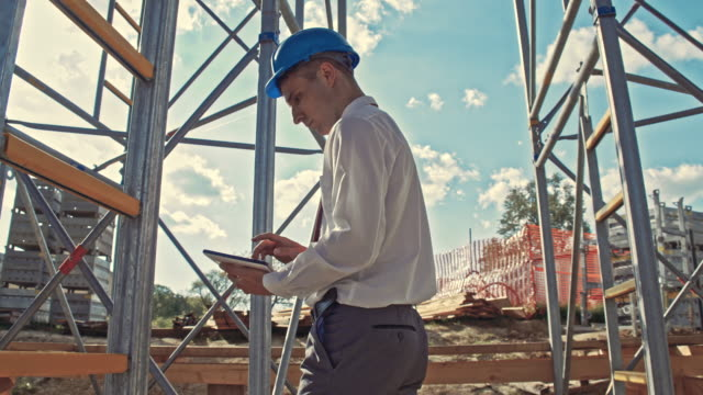 Civil engineer using digital tablet at the construction site
