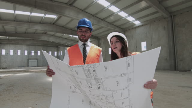 Civil Engineers Working at Construction