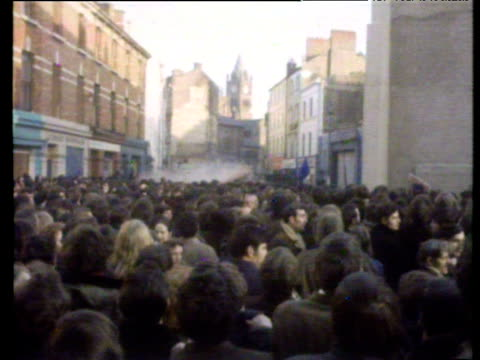 civil rights demonstrators are sprayed with water cannon by army at road block during protest which ended in bloody sunday shootings londonderry; 30... - 放水砲点の映像素材/bロール