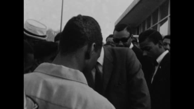 Civil rights leader Stokely Carmichael amid of crowd of college students in Nashville in 1967