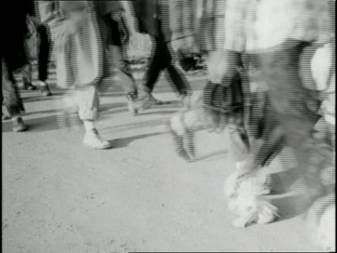 stockvideo's en b-roll-footage met civil rights supporters participate in a freedom march from selma to montgomery, alabama, in 1965. - 1965