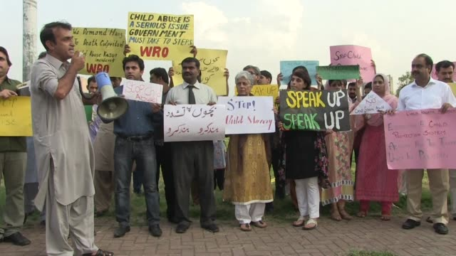 civil society activists gather outside the national press club in islamabad to protest against the child sex abuse scandal in punjab - punjab pakistan stock videos and b-roll footage