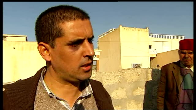 report on the vegetable seller who inspired national revolt Ali Bouazizi showing reporter his black eye Ali Bouazizi showing reporter mobile phone...