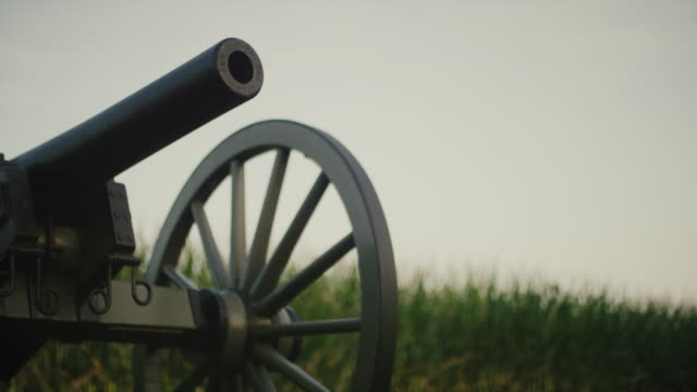 a us civil war cannon from gettysburg national military park, pennsylvania next to a corn field - gettysburg stock videos & royalty-free footage