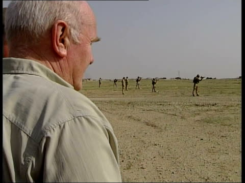 Civil war claims by former Iraqi Prime Minister Iyad Allawi John Reid comments AlMuthanna Province Line of British soldiers firing rifles Back view...