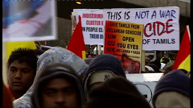 civil war continues: tamil sympathisers march in london; england: london: ext tamil-sympathisers march through streets chanting and carrying banners,... - war stock-videos und b-roll-filmmaterial