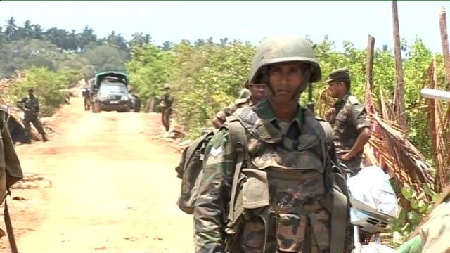 civil war government rejects ceasefire offer from tamil tiger rebels / offensive continues various shots of sri lankan army troops and vehicles - sri lanka stock videos and b-roll footage