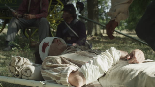 civil war soldier helping wounded man drink - injured stock videos & royalty-free footage