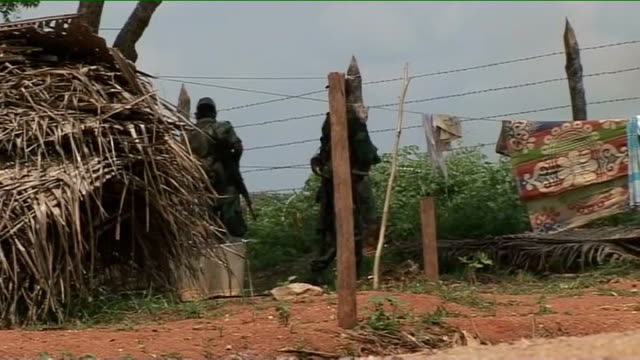 civil war tamil tiger militants given 24 hours to surrender barbed wire fence army troops standing guard at perimeter fence of camp views from moving... - sri lanka stock videos and b-roll footage