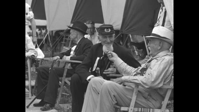 civil war veterans sitting outside tents at veterans encampment at gettysburg national battlefield / vs veterans seated at encampment 95yearold... - gettysburg stock videos & royalty-free footage