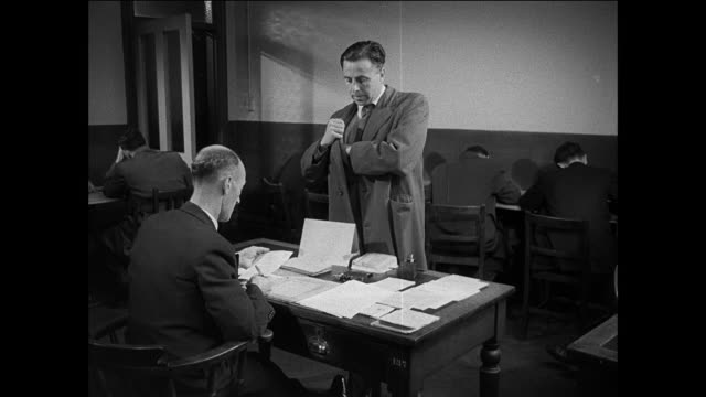 montage civilian arriving at an allocation center, filling out forms and waiting before taking a physical exam / united kingdom - registration stock videos & royalty-free footage