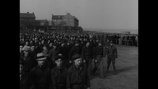 civilian conservation corps doctors checking young adult males. young adult males being recruited clothed large uniformed group gathering together in... - 1935 stock-videos und b-roll-filmmaterial