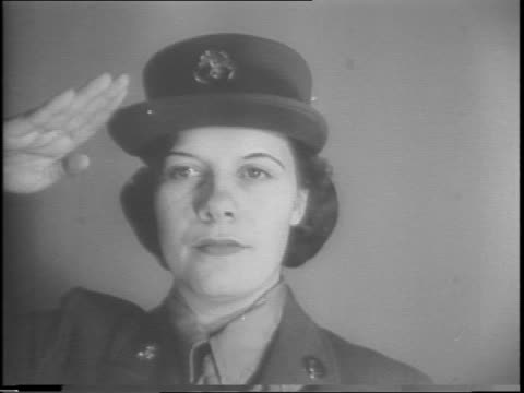 stockvideo's en b-roll-footage met civilian enlistees into the women's auxiliary army corps walk toward camera with luggage / women receive uniforms from window / woman checks off... - militaire training