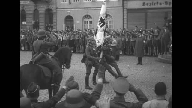civilian men knock down barrier and border checkpoint pole / border gate rises and people give nazi salute to germans riding horses into eger / women... - nazi swastika stock videos & royalty-free footage