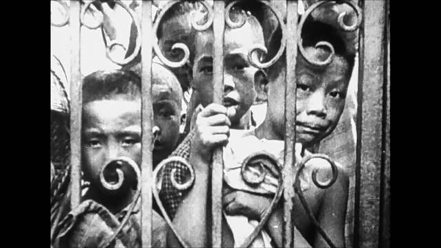 civilian population escaping bombing in the international settlement of shanghai / crowd panic running - 1937 stock videos & royalty-free footage