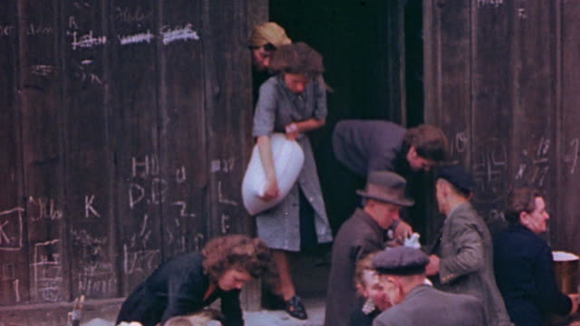 civilian refugees looting a warehouse for food during world war ii european campaign / germany  - 1945 stock-videos und b-roll-filmmaterial