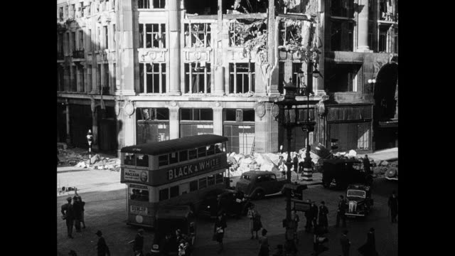 MONTAGE Civilian workers going to work amidst the ruin and rubble of the bombed city / London, England, United Kingdom