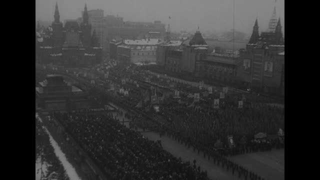civilians and soldiers parade through red square / vs stalin views parade from the tribune of lenin's mausoleum / paraders wave at him / vs parade,... - soviet military stock videos & royalty-free footage