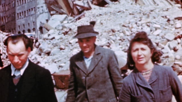 civilians carrying belongings from bombed and wrecked houses / germany - tracking shot stock videos & royalty-free footage