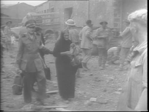 civilians coming out from hiding in the hills, elderly, mothers, and young children, carrying chairs and other belongings / civilians waiting in... - civilian stock videos & royalty-free footage