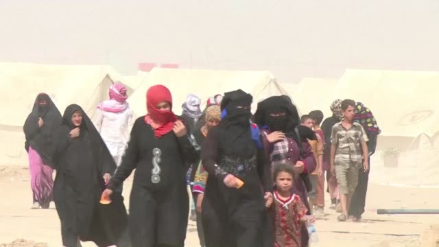 civilians desperate to flee fallujah were having to dodge sniper fire from the islamic state group which was keen to keep its human shields inside... - al fallujah stock videos & royalty-free footage