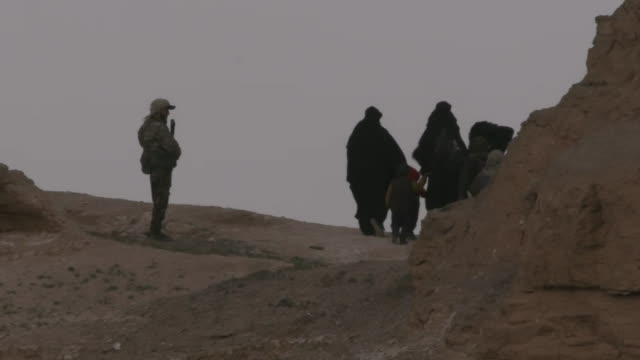 civilians evacuate an isis-held area of baghouz, syria on march 14, 2019. - (war or terrorism or election or government or illness or news event or speech or politics or politician or conflict or military or extreme weather or business or economy) and not usa stock videos & royalty-free footage