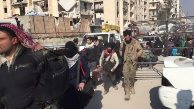 civilians evacuated from war-battered aleppo continue to arrive in the al-rashdeen district on the city's western countryside on december 19, 2016.... - shi'ite islam stock videos & royalty-free footage