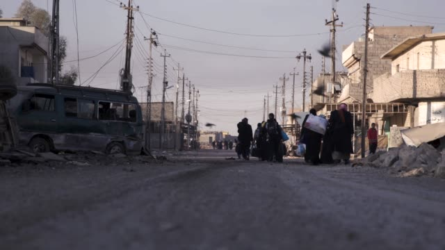 civilians fleeing the destroyed city of mosul thousands of civilians have fled the city of mosul due to the war against the islamic state - isis stock videos and b-roll footage