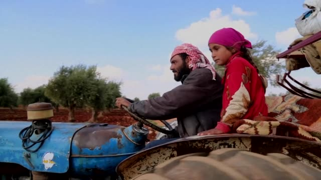 civilians from afrin on tuesday arrived in the village of anab east of afrin an area controlled by turkish backed syrian opposition after fighting... - people's protection units stock videos & royalty-free footage