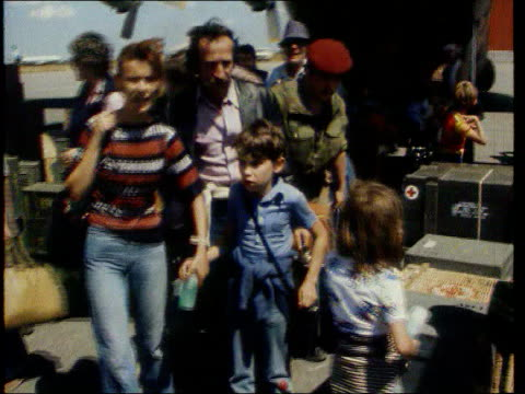 may in 1978 zaire was invaded by angola t21057806 tx civilians in street as armed soldiers walks by brussels refugees at airport / vox pops - コンゴ民主共和国点の映像素材/bロール